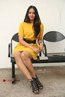 Actress Poojitha Stills in Yellow Short Dress at Darshakudu Movie Teaser Launch .COM 0192.JPG