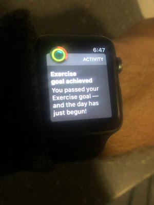"""Apple Watch saying """"You passed your exercise goal--and the day has just begun!"""