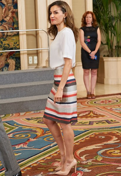 Queen Letizia wore BOSS HUGO BOSS Vistripy Pencil Skirt. met with Francisco de Vitoria University students. Prada Pumps and Tous gold earrings