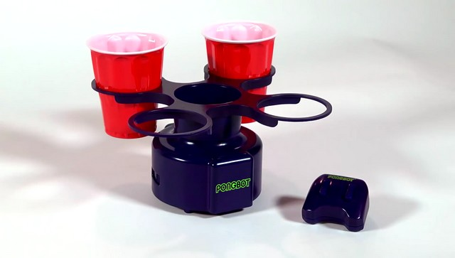 black color motorized pongbot with holder and remote