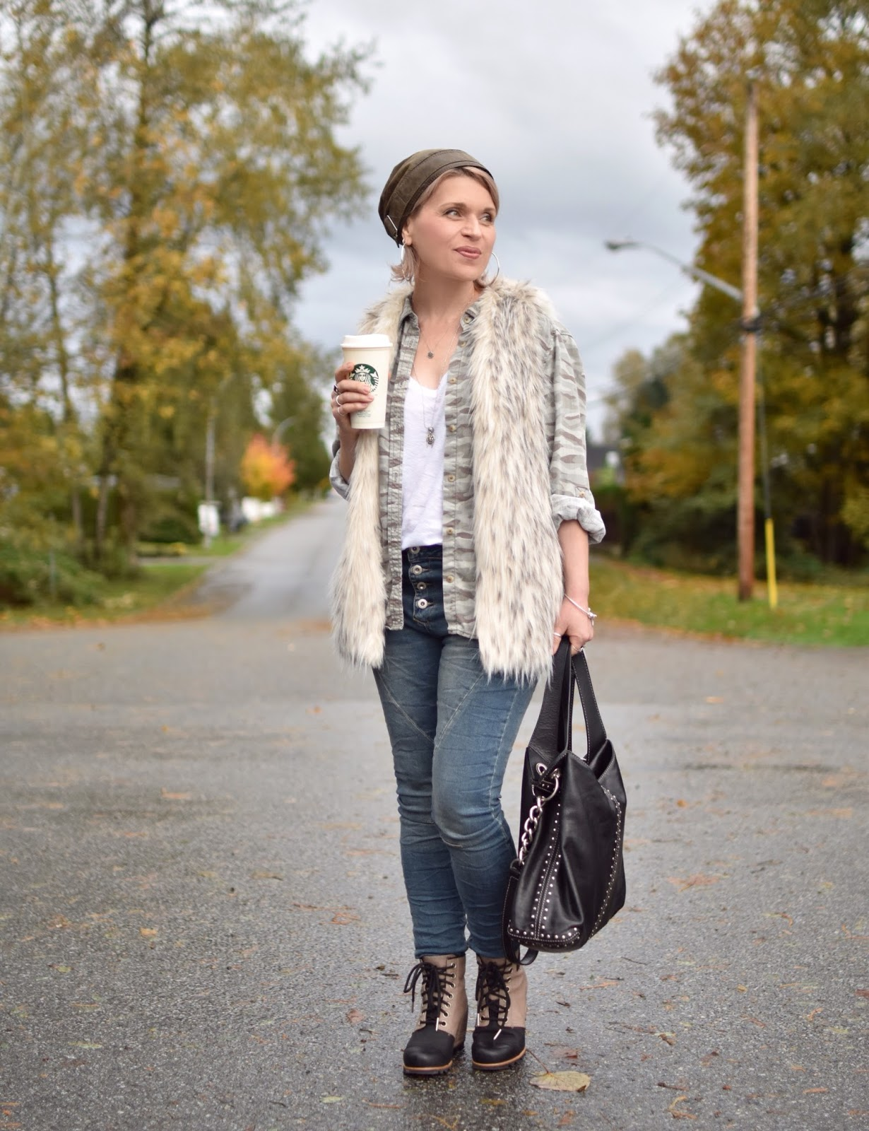 Outfit inspiration c/o Monika Faulkner - skinny jeans, camo shirt, faux-fur vest, Sorel booties, and leather beanie