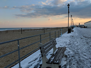 View of the beach and snowy boardwalk in late afternoon, Asbury Park, New Jersey