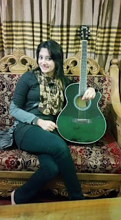 Puja Cherry Roy with Guitar