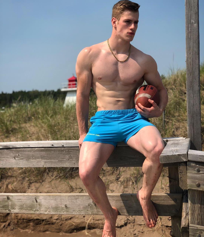 fit-shirless-blond-boy-huge-thighs-muscular-athlete-bro