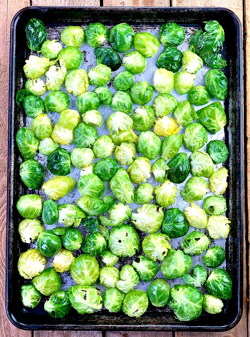 Baked Brussels Sprout Chips - Move over kale chips! Brussels sprout chips are the new low carb snack in town. I can't get enough of these salty, crunchy chips. Even the kids will love them, I swear!! #chip #brusseslsprouts #lowcarb #keto #snack #easy #recipe | bobbiskozykitchen.com