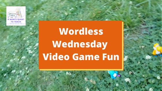 A Mom's Quest to Teach logo; Wordless Wednesday: Video Game Fun; Yoshi toys in grass