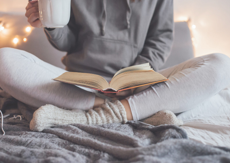 A day reading a book in bed in a post about 13 simple tasks you can do to set you up for a productive week.