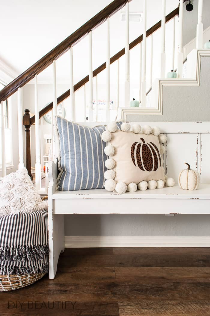 entryway with farmhouse bench and pillows