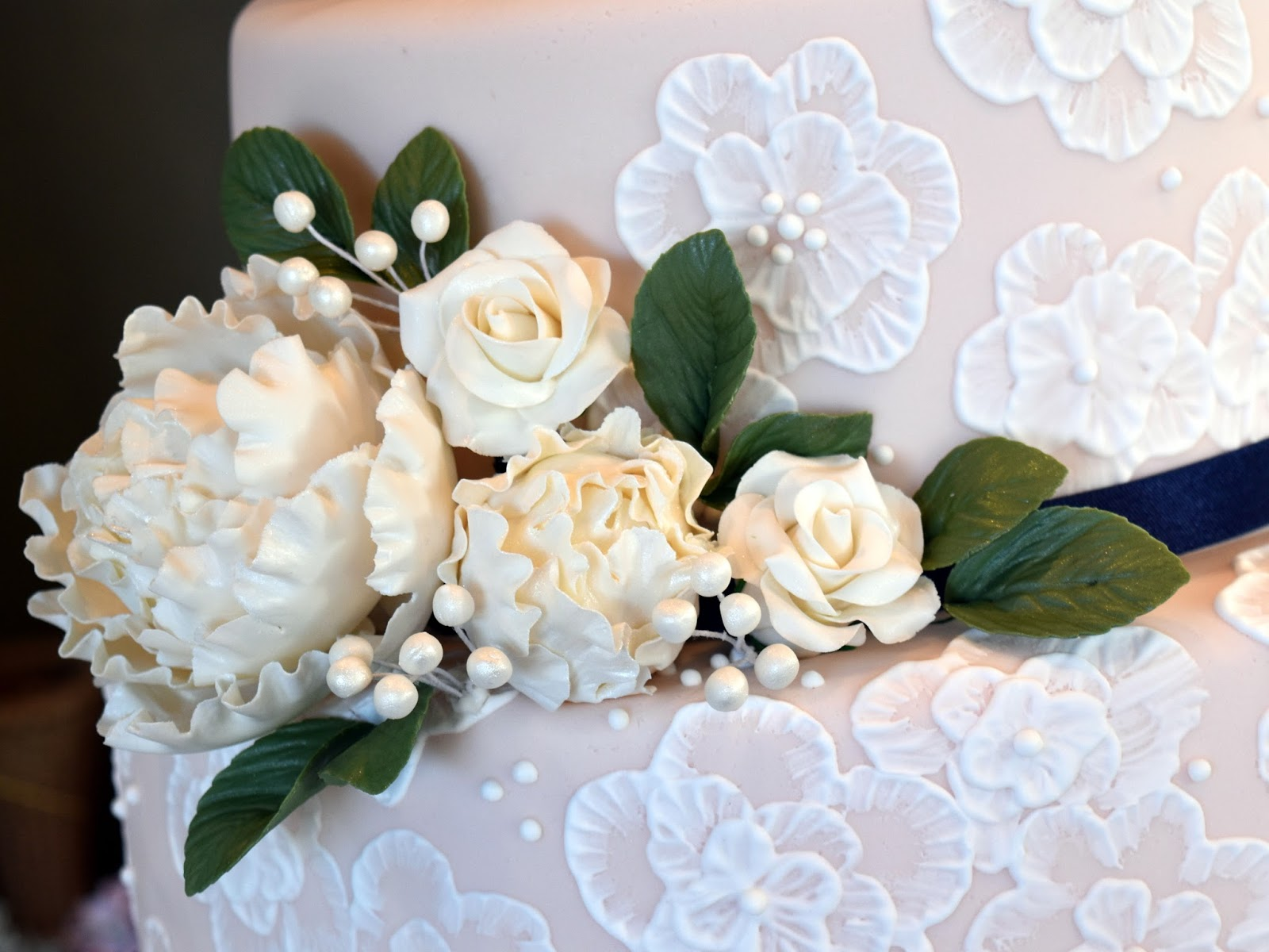 The wedding cake project july 2017 i covered this cake with blush pink fondant i used white royal icing to create the embroidered floral design the ivory peonies roses berries izmirmasajfo