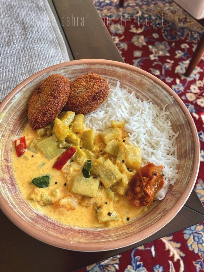 Lauki curry server with rice, chicken cutlets and lime pickle