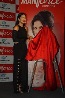 Sunny Leone figure Hugging Black Dress sexy curves hot fuckable body launches condom