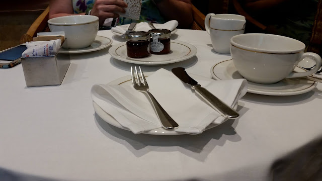 Posh afternoon tea, complete with cake forks.