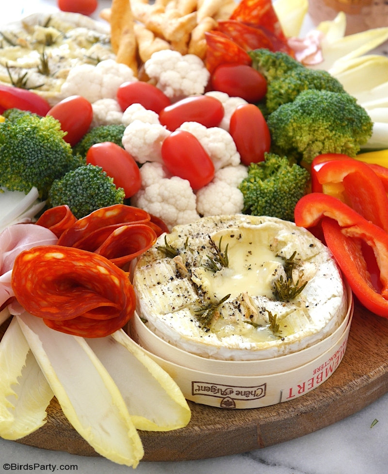 Camembert Cheese Fondue Board - quick and easy baked recipe for a lighter winter fondue that is perfect as a sharing appetizer or a dinner party! by BirdsParty.com @birdsparty #fondue #cheesefondue #renchfondue #fonduerecipe #camemebertrecipe #camembertfondue #bakedbrie #fondueboard #cheeseboard