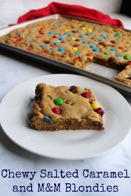 Chewy brown sugary blondies loaded with chocolate chunks, caramel undertones and topped with M&Ms. This big batch of bars is perfect for a party, carry-in or just because.