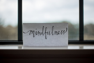 """image of paper near window that says """"The present moment is filled with joy and happiness. If you are attentive, you will see it."""" Thich Nhat Hanh"""