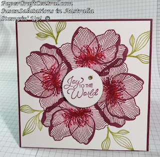 With a template it is easy to create a wreath using a flower stamp. This Chrstmas card features the Floral Essence stamp set.