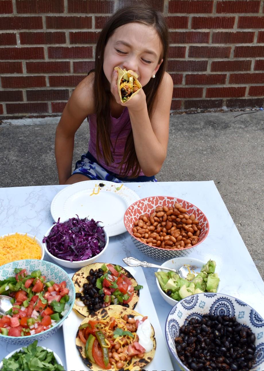girl eating taco