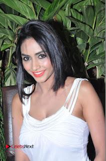 Actress Model Pooja Sri Stills in White Short Dress at F Club pre soft Launch  0146.JPG