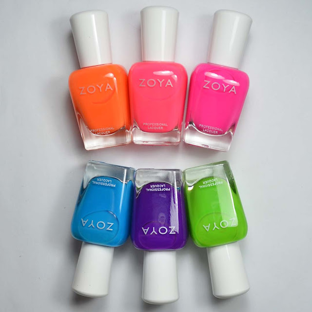 neon nail polish in bottles arranged in a flat lay