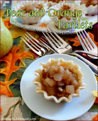 Pear and Orange Tartlets. These individual mini tarts featuring pears, orange, and the crunch of pecans are as delicious as they are beautiful. | Recipe developed by www.BakingInATornado.com | #bake #dessert