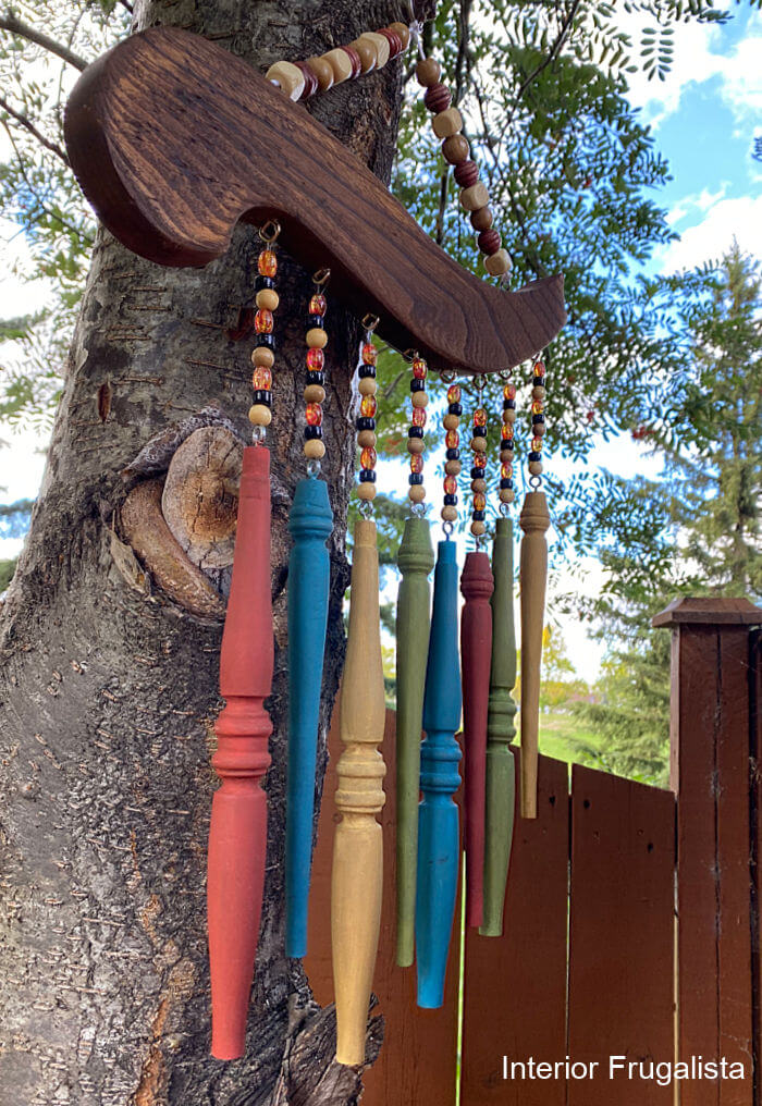 How to repurpose salvaged spindles and an arm from an old wooden chair into rustic outdoor chair spindle wind chimes that cost very little to make.