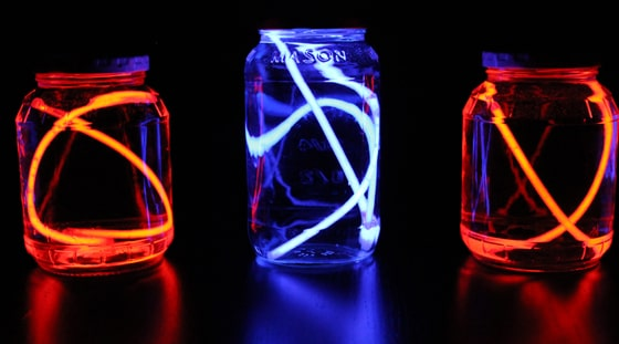 red and blue glow lanterns made from empty jars and glow sticks