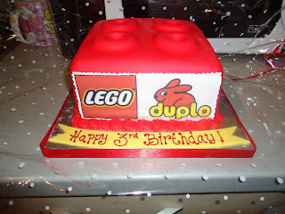 A Red Lego Duplo Brick Birthday Cake