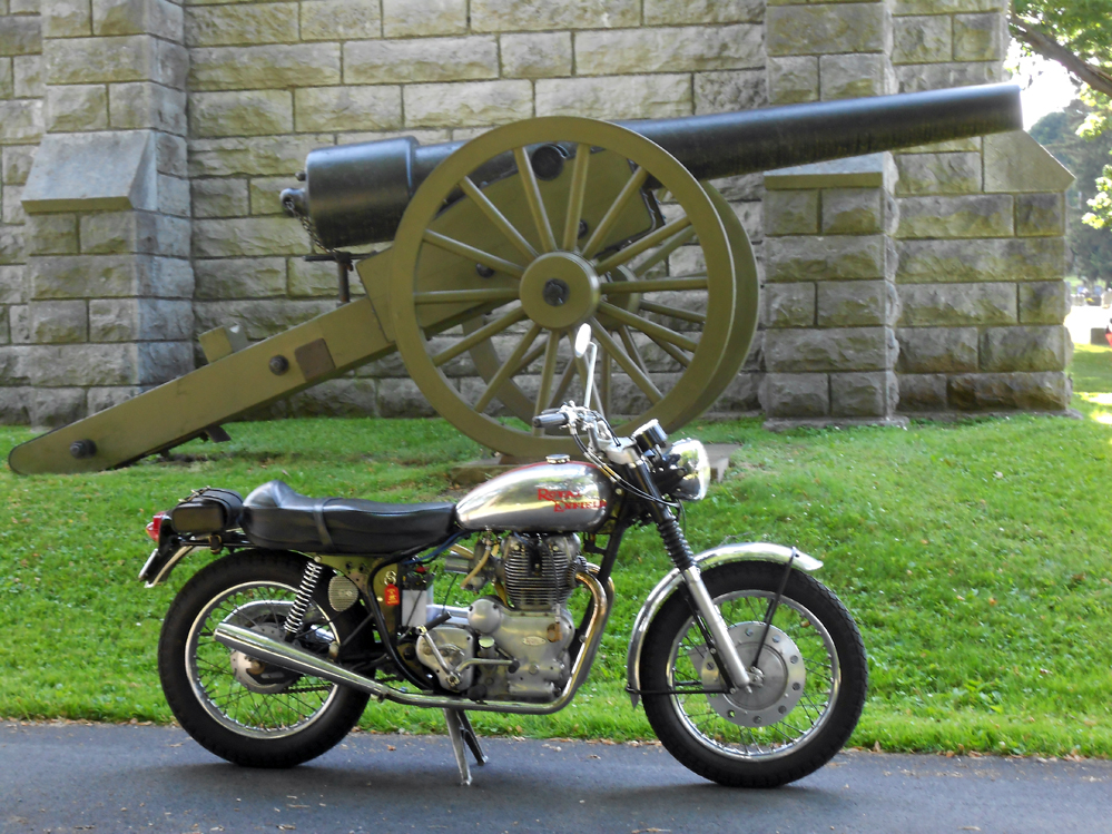Royal Enfield Interceptor in front of a Civil War cannon.