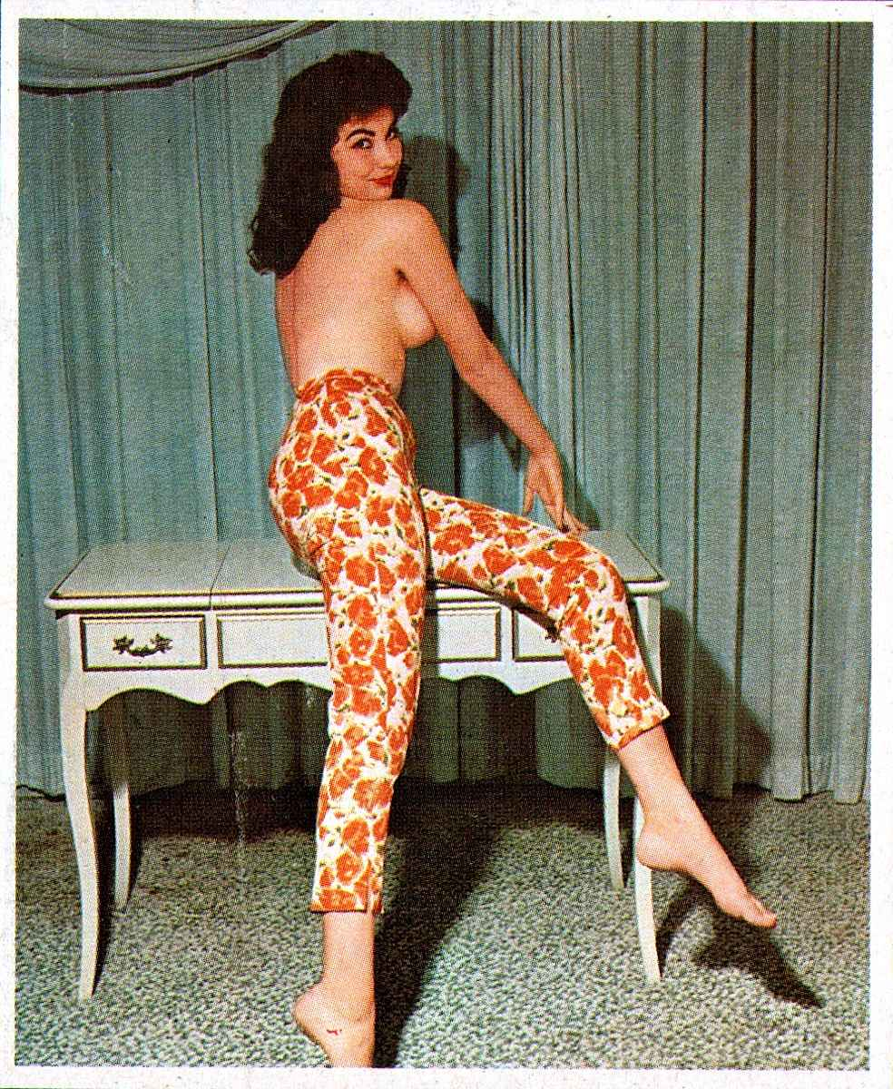 from a 1963 men's magazine, a topless woman in orange slacks