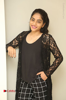 Actress Punarnavi Bhupalam Stills in Black Dress at Pittagoda Press Meet  0021.JPG
