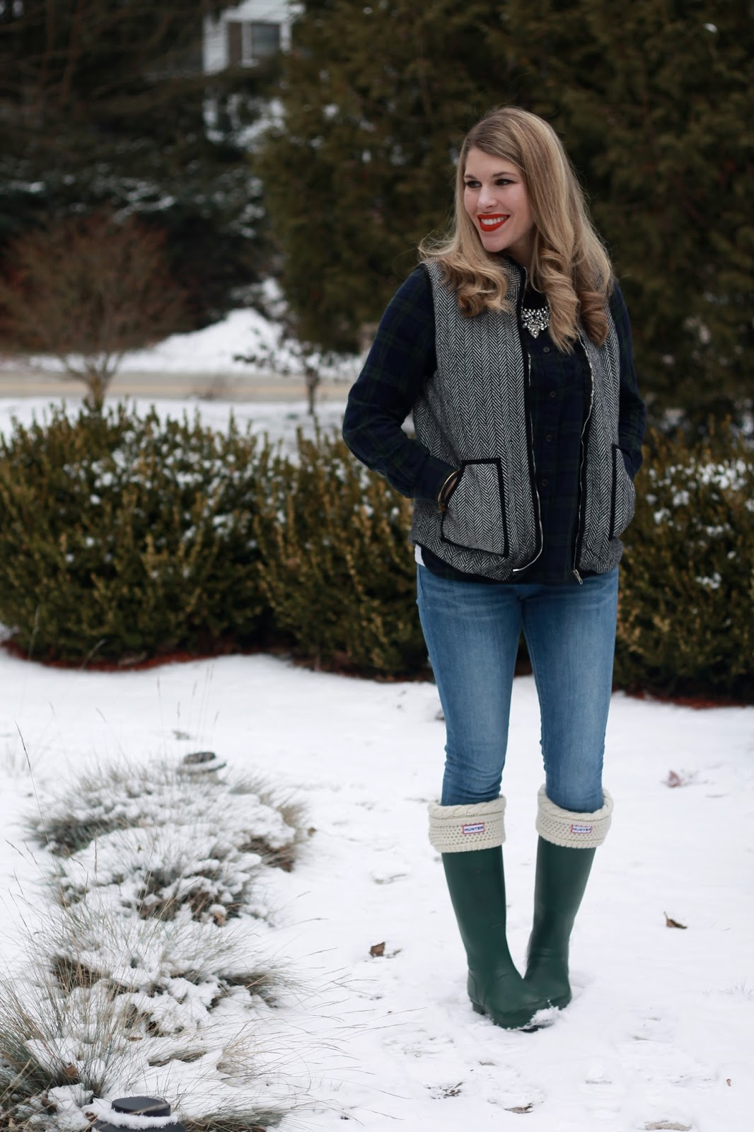 navy and green plaid flannel, herringbone vest, express skinny jeans, green hunter boots