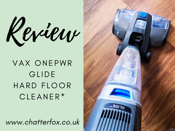 Image showing a picture of the VAX ONEPWR Glide Hard Floor Cleaner in use on oak effect laminate. Alongside a green square that contains the words review, VAX ONEPWR Glide Hard Floor Cleaner www.chatterfox.co.uk