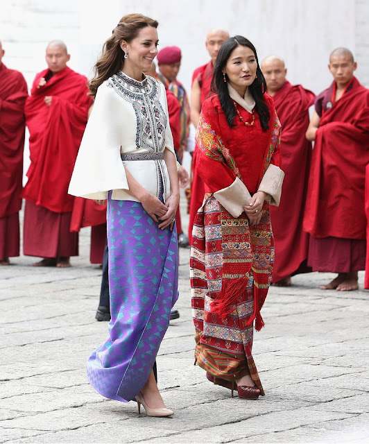 Britain's Prince William and Catherine, Duchess of Cambridge walk with King Jigme Khesar Namgyel Wangchuck and Queen Jetsun Pema