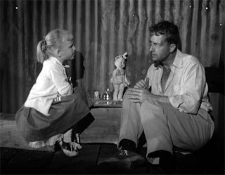 Xandra Conkling and Robert Clarke share a cup of imaginary tea in The Hideous Sun Demon (1958)