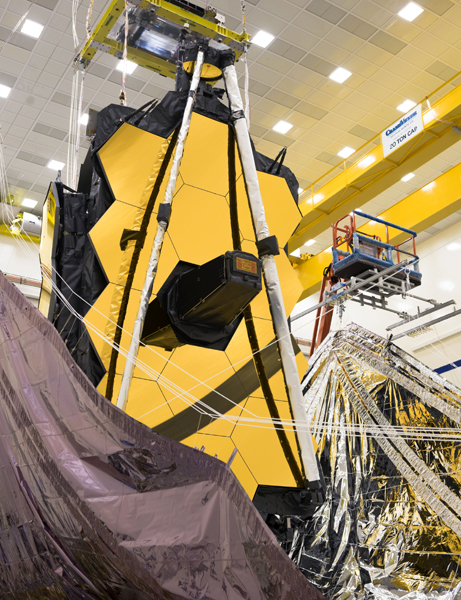 At the Northrop Grumman facility in Redondo Beach, California, technicians begin stowing the sunshield on NASA's James Webb Space Telescope...in preparation for its trip to its South American launch site this summer.