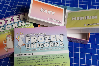Frozen Unicorns Family Party Game box contents cards and instructions