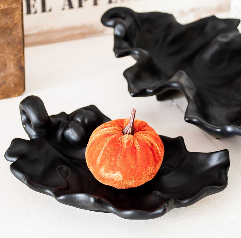 black dishes with orange pumpkin
