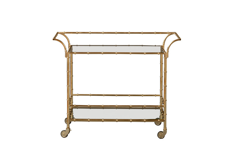 Metal faux bamboo bar cart with glass shelves and a gold finish by Lilly Pulizter