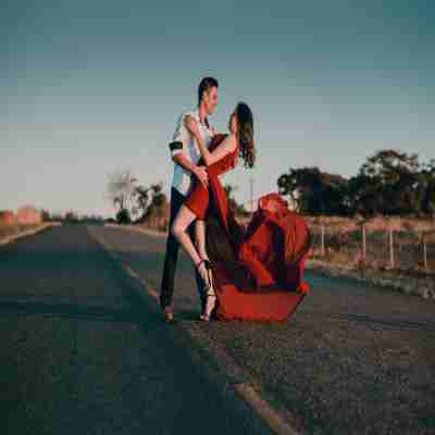 gf and bf dancing on a road