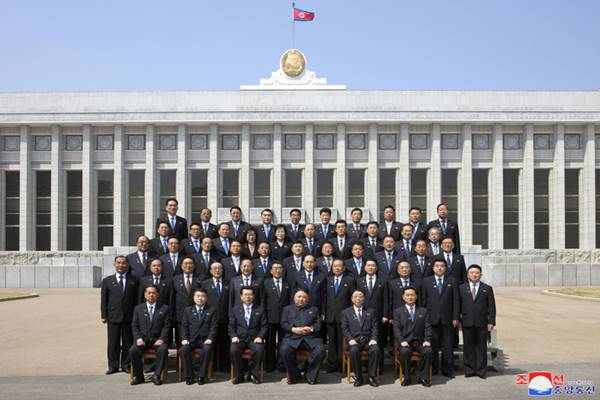 kim jong un with new cabinet members