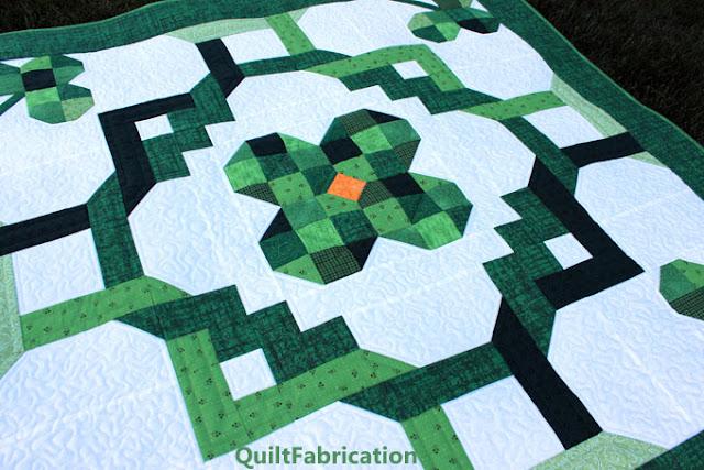 green four leaf clover quilt