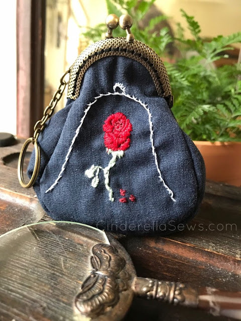 Beauty and the Beast Enchanted Rose Coin Purse is hand embroidered and sewn with a metal clasp for a beautiful fairy tale finish style. The perfect gift for Enchanted Rose and Disney lovers or to spoil yourself with a lovingly made nod to fan art #beautyandthebeast #enchantedrose #embroidery #fanart #coinpurse #handmadegifts