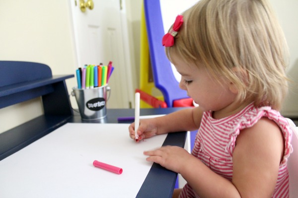 Organized art station for kid's art and craft supplies: Use metal buckets to easily label and store supplies