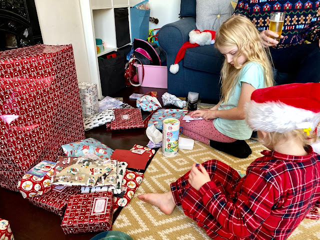 My daughter's opening their Christmas presents