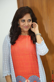 Actress Anasuya Bharadwaj in Orange Short Dress Glam Pics at Winner Movie Press Meet February 2017 (55).JPG
