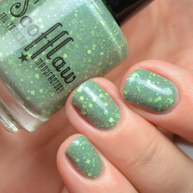 green nail polish with green and blue glitter