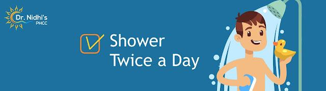 A boy taking a shower