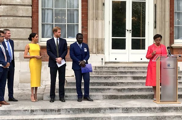 Meghan Markle wore Brandon Maxwell Yellow Crepe Midi Dress, Manolo Blahnik suede pump, Adina Reyter Diamond Amigos Curve Post Earrings