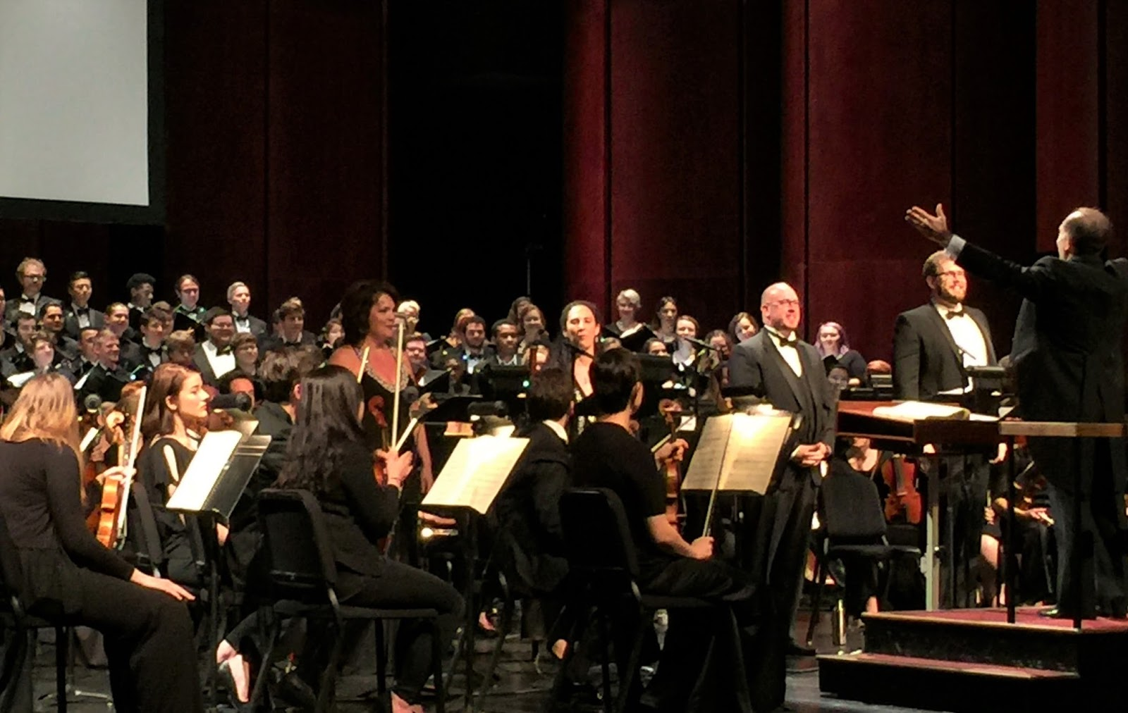 IN PERFORMANCE: (from left to right) Soprano JILL BOWEN GARDNER, mezzo-soprano STEPHANIE FOLEY DAVIS, tenor DANIEL C. STEIN, bass-baritone DAVID ANDERSON WEIGEL, and conductor DR. KEVIN M. GERALDI accepting the audience's applause for UNCG School of Music's performance of Giuseppe Verdi's MESSA DA REQUIEM, 24 February 2017 [Photo by the author]
