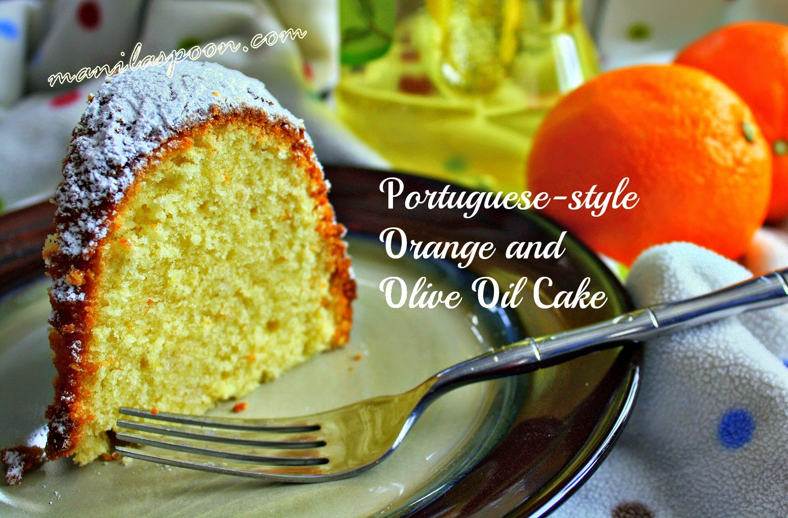 Moist and so delicious, this orange and olive oil cake is bursting with fruity flavors from fresh orange juice and cranberries. Perfect for your Christmas or New Year dessert table! | manilaspoon.com